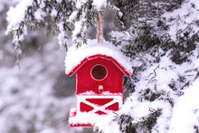 Red Barn Birdhouse Covered In Snow