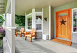 canvas print picture - Spacious concrete porch with wooden chairs and nice entry door.