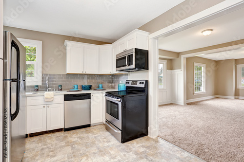 Fototapeta Kitchen room interior with white cabinets and tile floor. obraz na płótnie