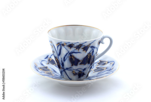 Fotografie, Obraz  Porcelain cup and saucer on a white background
