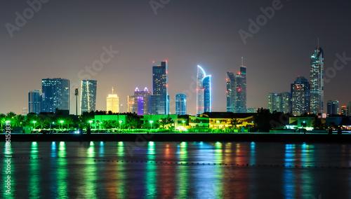Foto op Plexiglas Japan Amazing night dubai downtown skyline with tallest skyscrapers and beautiful Jumeirah beach reflection, Dubai, United Arab Emirates