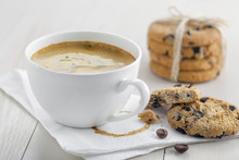 Cup Of Coffee On A Napkin With Biscuits For Dessert.  Coffee Break With Chocolate Cookies.