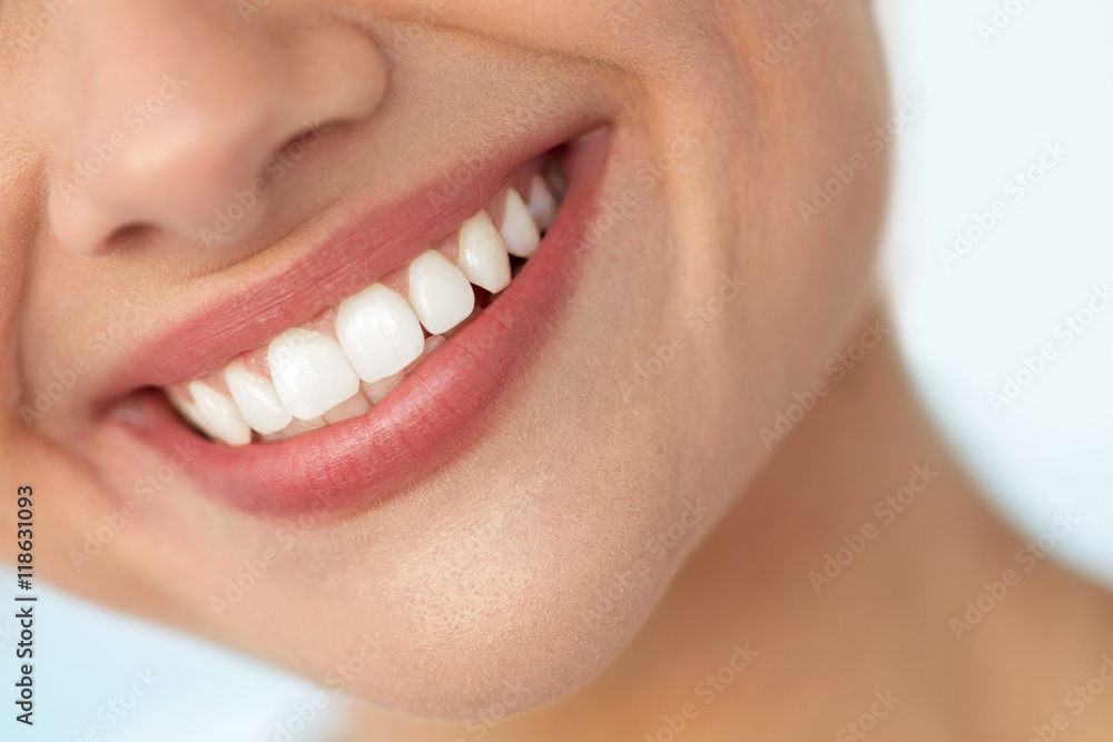 Fototapeta Closeup Of Beautiful Smile With White Teeth. Woman Mouth Smiling. High Resolution Image