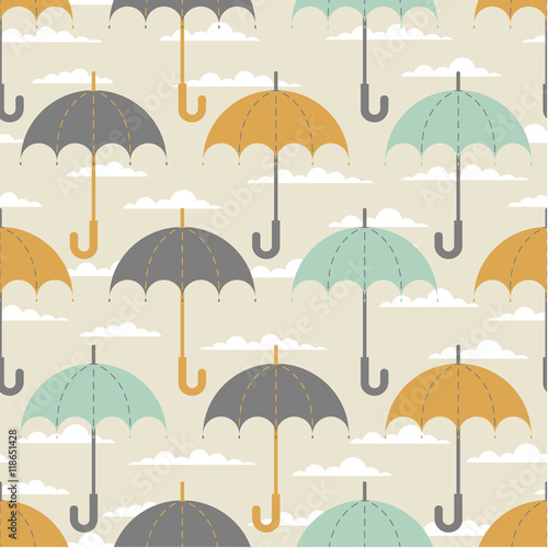 Seamless texture. Autumn. Depicts the umbrellas of the same size .Umbrella in three colors : grey, yellow and blue .Umbrellas in the clouds. Umbrellas on a beige background. - 118651428