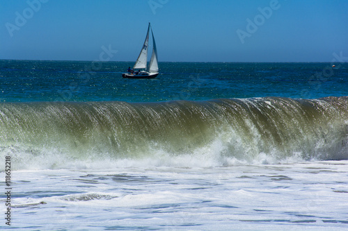 Sailing Boat with Pacific Huge Wave Poster
