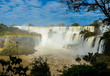 Stunning view of Iguazu waterfalls on a sunny day with the rainbow. Photo taken from the Argentina side.