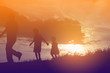 Happy family dancing on the road in the sunset time. Evening par