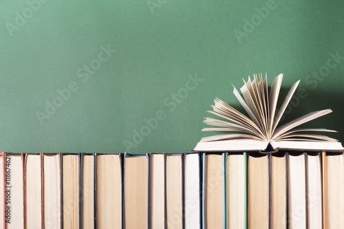 Stampa su Tela Open book, hardback books on wooden table