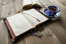 Bibles And Cup Of Tea On Wood ...