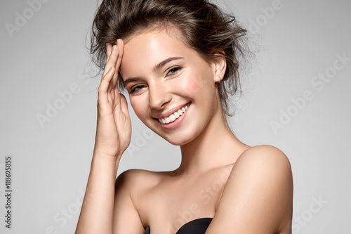 Plakat Portrait of a smiling young pretty woman with natural make-up and clean skin