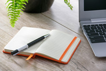 Personal Notes In Orange Notepad