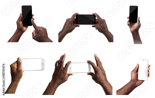 Fotografía  Male hands holding mobile smart phone and tablet with blank screen, isolated on white
