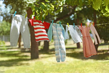Baby Laundry Hanging On Clothe...