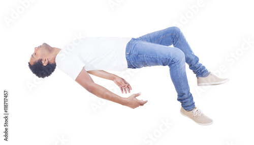 Interracial man floating on white background Wallpaper Mural