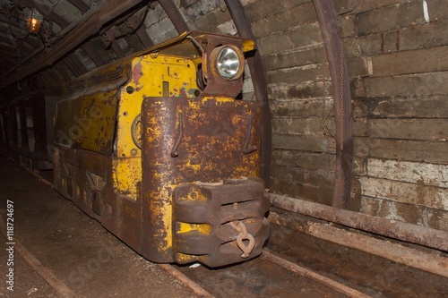 Foto op Aluminium Rudnes Mine railway in undergroud. Modern coal mine . Real underground post mine illuminated tunnel .