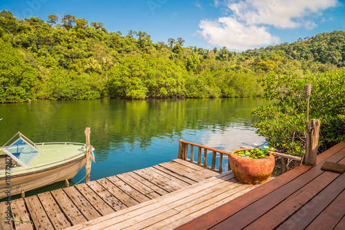 Keuken foto achterwand Bergen Beautiful canal with green mountain in sunny day blue sky background - Tropical summer holiday concept.
