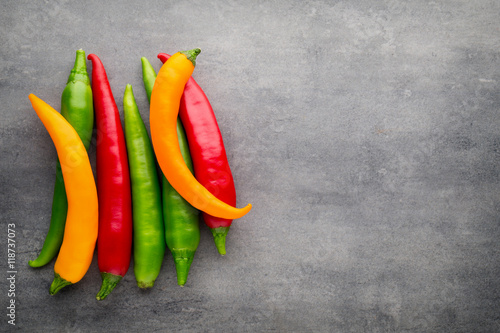 Staande foto Hot chili peppers Chilli pepper on the grey background.