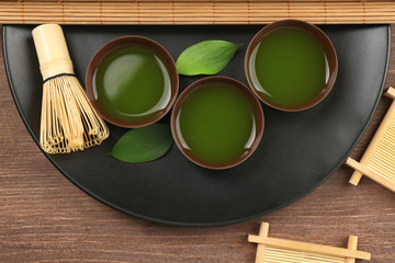 FototapetaGreen matcha tea set on wooden table, top view