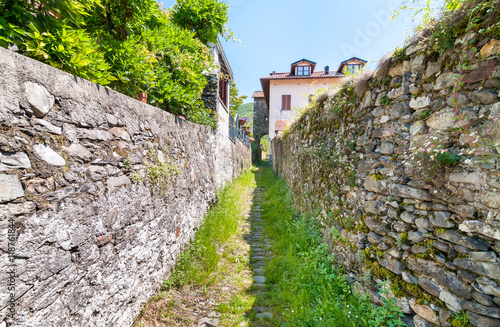 Valokuva Landscape with narrow street with stone walls of the Maccagno, is a village at t