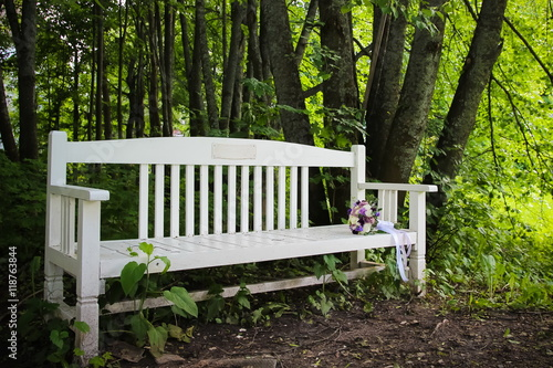 Remarkable Wedding Bouquet Lies Over A Wooden Street Bench Buy This Ibusinesslaw Wood Chair Design Ideas Ibusinesslaworg