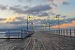 Beautiful wooden pier at sunrise