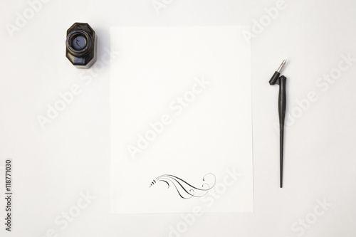 Fototapeta  white blank paper sheet mockup with calligraphy nib and ink