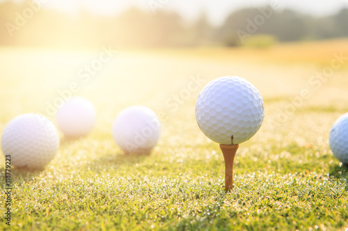 In de dag Golf Golf ball on a tee against the golf course with copy space
