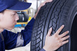 Expert mechanic checking a tyre