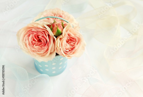Delicate garden roses in vintage tin bucket blue polka dot, ribbons Tablou Canvas