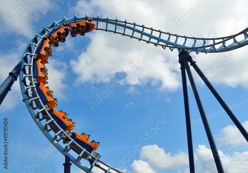 Foto  Roller coaster  ride filled  with thrill seekers