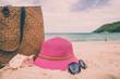 Beach accessories on the tropical island beach, summer holiday