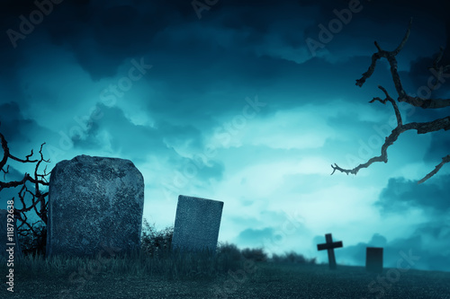 Creepy atmosphere in the cemetery with tombstone Canvas Print