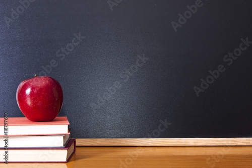 books with apple and pen on the desk Fototapeta