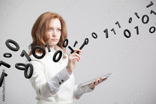 Obraz na płótnie Woman working with binary code, concept of digital technology.
