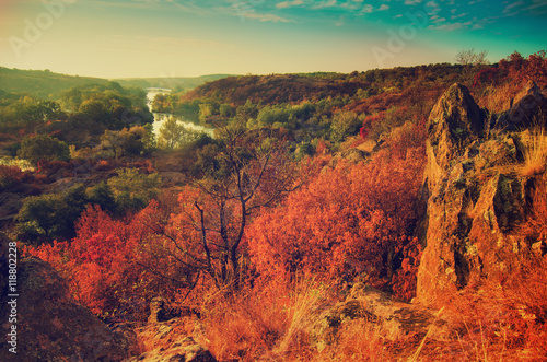 Foto op Canvas Baksteen Rural autumn beautiful landscape with river and colorful trees, seasonal vintage background