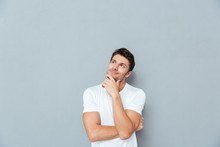 Pensive Attractive Young Man S...