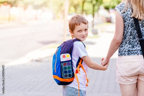 Fotografia, Obraz  7 years old boy going to school with his mother