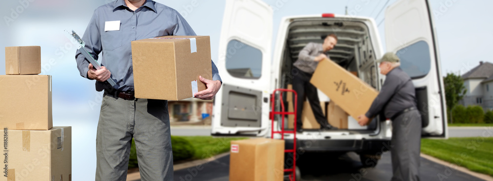 Fototapeta Delivery man near shipping truck.