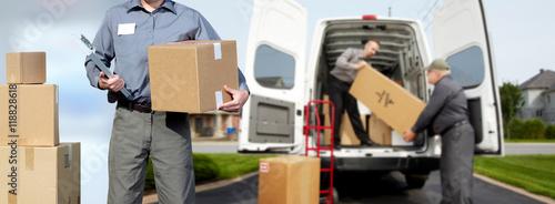 Fototapeta Delivery man near shipping truck. obraz