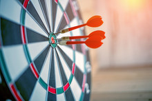 Red Dart Arrow Hitting In The Target Center Of Dartboard Business Success Ideas Concept