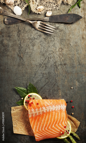 Raw salmon fillet and ingredients for cooking Wallpaper Mural