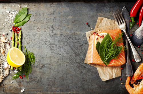 Raw salmon fillet and ingredients for cooking Canvas Print