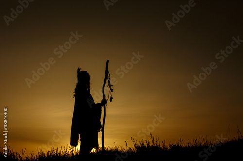 silhouette of native american shaman with pikestaff on backgroun Wallpaper Mural