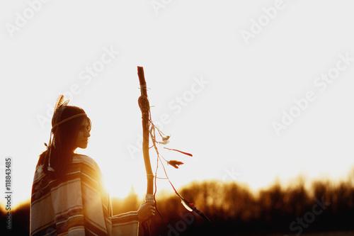 Fototapeta native american woman  shaman with pikestaff on background of su