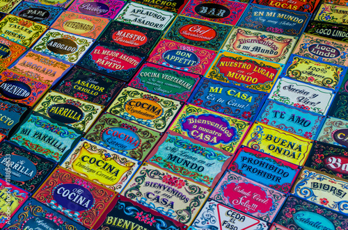 Background of colorful door signs, made in traditional Buenos Aires and Argentina style of painting called fileteado, at a weekend fair in San Telmo neighborhood, Buenos Aires