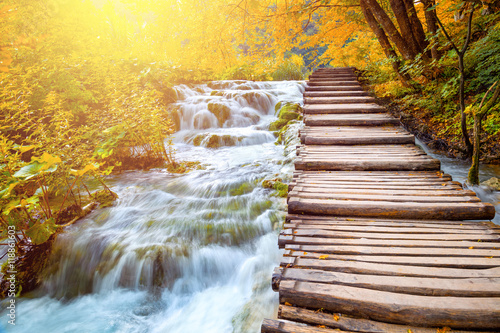 Photo sur Toile Jaune de seuffre Scenic waterfalls and wooden path - picturesque autumn