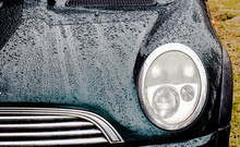 South Africa, Queenstown, 20 August 2016,Mini Cooper Car Bonnet With Rain Drops Rolling Off