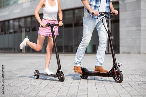 Fotografía  Pleasant friends using scooter.