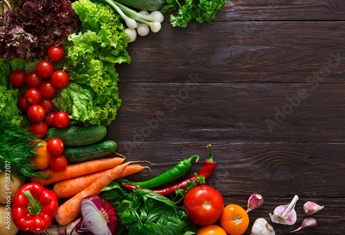 Frame of fresh vegetables on wooden background with copy space
