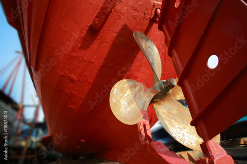 Lower part of stern and propeller of a fishing boat in a shipyard.